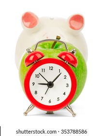 Fresh green apple with alarm clock and piggy bank on isolated white background