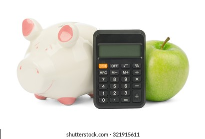 Fresh green apple with calculator and piggy bank on isolated white background