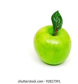 fresh green apple with green leaf isolated on white