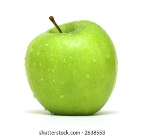 Fresh Green Apple with water droplets against a white background