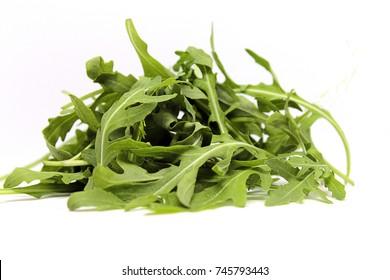 fresh green arugula on the white background