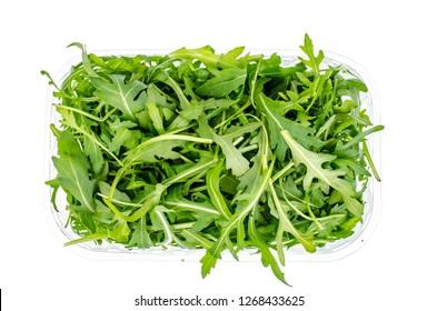 Fresh green arugula in package isolated on white background. Studio Photo