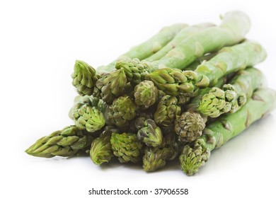 Fresh green asparagus isolated on white background.