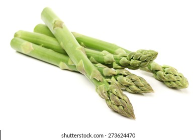 Fresh green asparagus on white