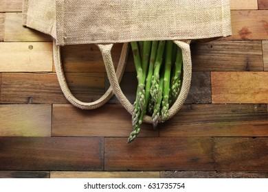 Fresh green asparagus on wooden background. vegetarian and vegan green menu.