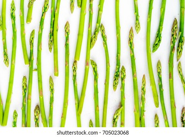 Fresh green asparagus shoots pattern, top view. Isolated over white. Food background asparagus flat lay pattern
