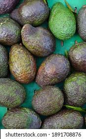 Fresh green avocados at the farmers market
