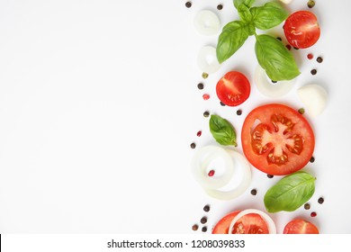 Fresh green basil leaves, tomatoes and mozzarella on white background, top view