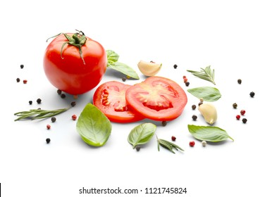 Fresh green basil with tomatoes and spices on white background