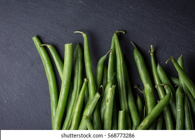 Fresh green beans on slate