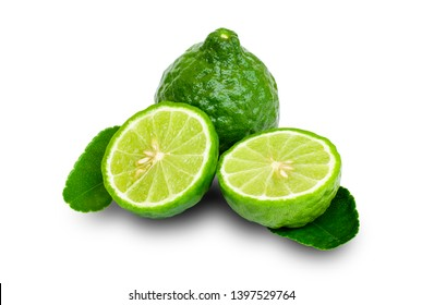Fresh green Bergamot or kaffir lime fruit with cut in half and leaves isolated on white background with clipping path.