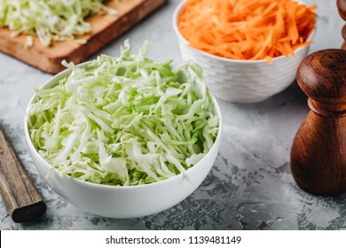 Fresh green cabbage cut. Sliced cabbage in bowl. Ingredients for cole slaw salad