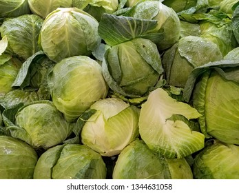 fresh green cabbage heads with water droplets at the market