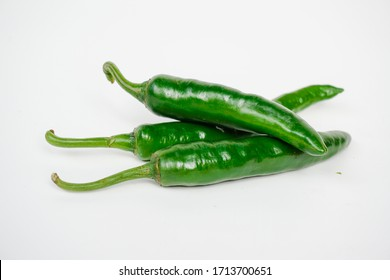 Fresh green chili pepper isolated on a white background