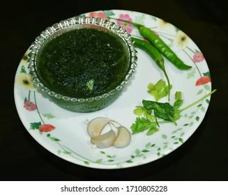 Fresh Green Coriander Chutney also called as Dhaniye ki Chutni in Hindi Language isolated in black background. Indian Food or dish - Shutterstock ID 1710805228