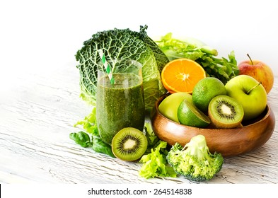 Fresh green detox vitamin  smoothie on white background for healthy snack