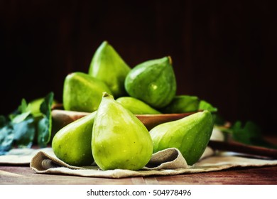Fresh green figs, still life in rustic style, vintage wood background, selective focus
