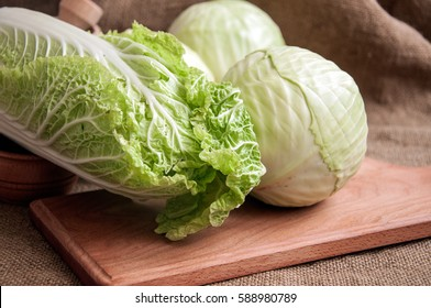 Fresh green garden cabbage on rustic wooden background. Whole fresh green cabbage on wooden background . Vegetable green cabbage. Vegetarian food. Place for text. Cabbage soup diet.
