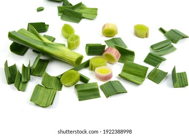 Fresh green garlic isolated on white background. Chopped green garlic.