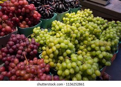 Fresh green grape fruit close up background