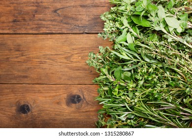 fresh green herbs on wooden table, top view
