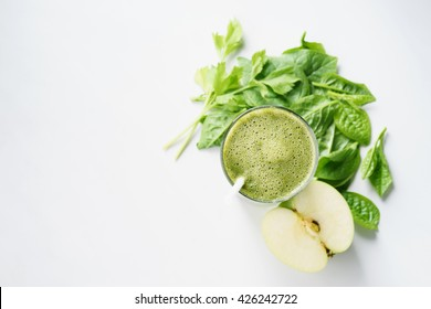 Fresh green juice smoothie made with organic green fruits and vegetables