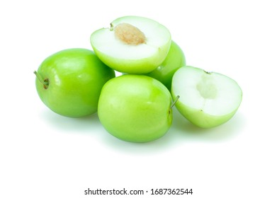 Fresh green jujube fruits, Delicious Chinese jujube fruits with slice isolated on white background. The file includes a clipping path easy to use. Close-up.