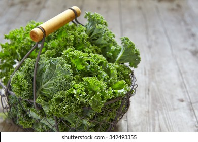 Fresh green kale leaves on wooden table