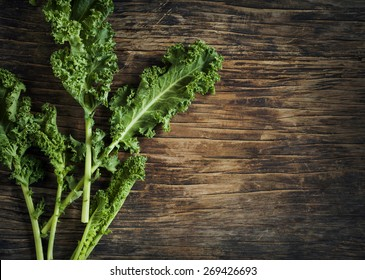 Fresh Green Kale on wooden background
