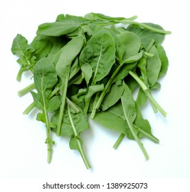 fresh green leaves arugula isolated on white background. Organic vegetable