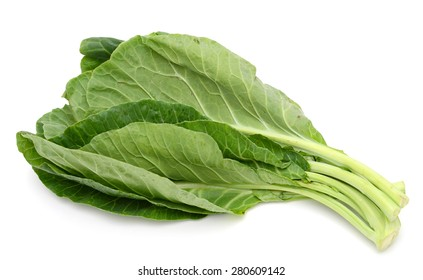 fresh green leaves of collards isolated on white