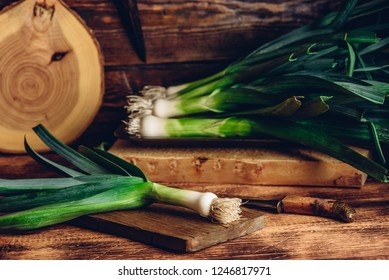 Fresh green leek on wooden cutting board