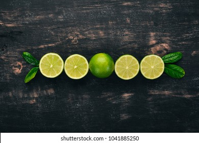 Fresh Green Lime. Fruits. On a wooden background. Top view. Copy space.
