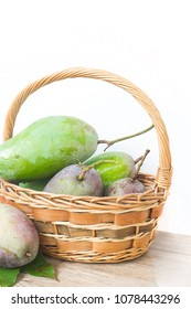 Fresh green mango from the garden in basket.