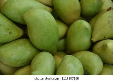 Fresh green mangoes closeup