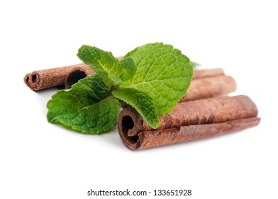 Fresh green mint and cinnamon isolated on white background