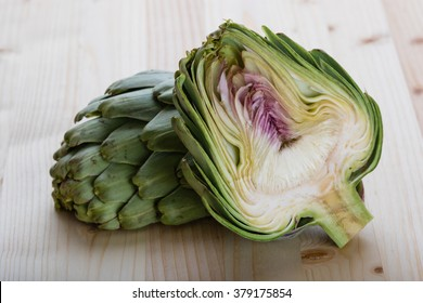fresh green organic healthy sliced artichoke on wooden table