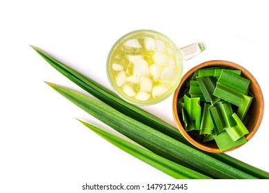 Fresh green pandan leaves and glass of ice pandan juice isolated on white background . Healthy herbal drinks concept. Top view. Flat lay.