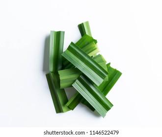 fresh green pandan screwpine leaves isolated on white background