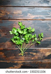 Fresh green parsley on wooden rustic table. Top view.