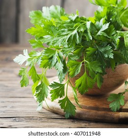 Fresh green parsley on the wooden table, selective focus and square image