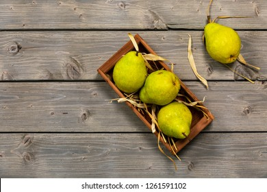 Fresh Green Pears on a Wooden Table Top View. Selective focus.
