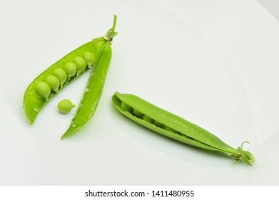 Fresh green peas isolated on a gray background
