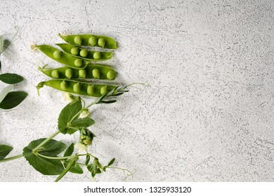 Fresh Green peas pod on white
