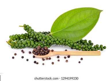 Fresh green peppercorns and black peppercorns isolated on white background