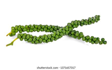Fresh green peppercorns on white background