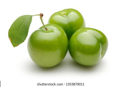 Fresh green plums with leaf isolated on white background