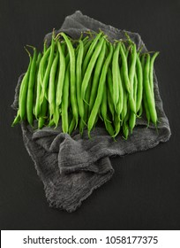 fresh green princess beans on dark slate kitchen plate, rusty shabby chic, can be used as background