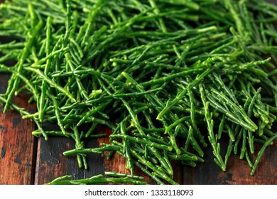 Fresh green raw samphire on wooden table