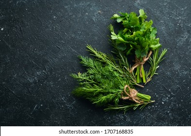 Fresh green rosemary, parsley and dill on the table. Top view.